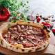 Pizza with anchois and garlic on wooden board. - PhotoDune Item for Sale