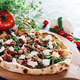 Pizza with dried tomatoes, mozzarella, sausage and rocket - PhotoDune Item for Sale