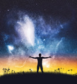 Happy man spreading hands on starry night sky. - PhotoDune Item for Sale