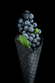 Black wafer cone with frozen blueberry fruits. Ice cream - PhotoDune Item for Sale