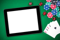 Mock up template tablet on casino poker table - PhotoDune Item for Sale