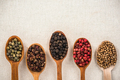 Selection of pepper seeds on wooden spoons - PhotoDune Item for Sale