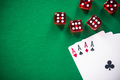Four aces poker cards and red dices on casino table - PhotoDune Item for Sale
