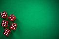 Red poker dices on green casino felt, spotlight background - PhotoDune Item for Sale