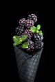Black wafer cone with frozen blackberry fruits. Ice cream - PhotoDune Item for Sale