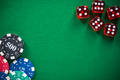 Casino chips and red dices on green empty felt - PhotoDune Item for Sale