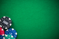 Casino chips on green empty cloth, spotlight background - PhotoDune Item for Sale