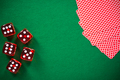 Poker cards and red dices on green casino felt - PhotoDune Item for Sale