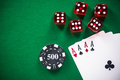 Casino poker games related items on green table - PhotoDune Item for Sale