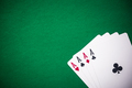 Four aces folded on green casino table, copy space - PhotoDune Item for Sale