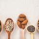 Superfood on wooden spoons on kitchen cloth - PhotoDune Item for Sale