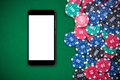 Mobile phone and casino chips on poker table - PhotoDune Item for Sale