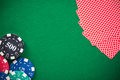 Casino chips and poker cards on green felt, background - PhotoDune Item for Sale