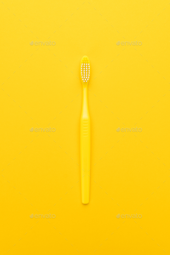 Plastic Toothbrush on Yellow Background - Stock Photo - Images