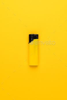 Plastic Lighter on Yellow Background