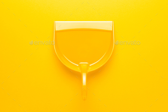 Plastic Dustpan on Yellow Background - Stock Photo - Images