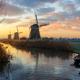 Windmills at sunrise in a rural dutch landscape - PhotoDune Item for Sale