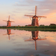 Two windmills with reflection at sunset - PhotoDune Item for Sale