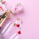 Bottle of champagne on pink background - PhotoDune Item for Sale