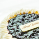 Blueberry cheese cake with happy birthday sign on top - PhotoDune Item for Sale