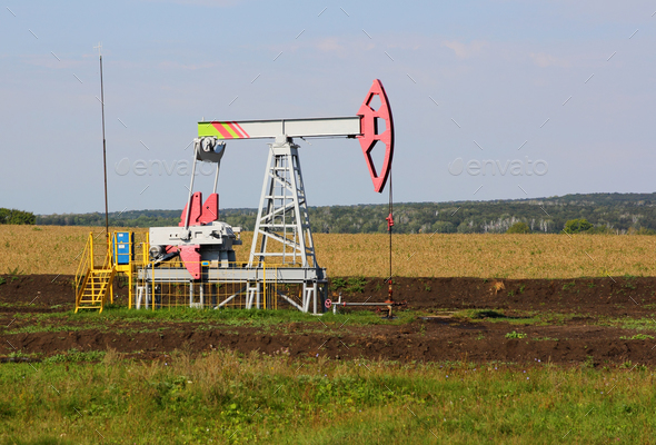 Oil pumpjack. Oil industry equipment. - Stock Photo - Images