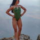 Fitness girl posing with a beautiful green 