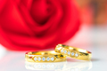 Close up Red roses and gold rings on white_-6 - PhotoDune Item for Sale