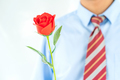 Man holding red rose in hand on white_-12 - PhotoDune Item for Sale