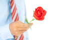 Man holding red rose in hand on white_-16 - PhotoDune Item for Sale