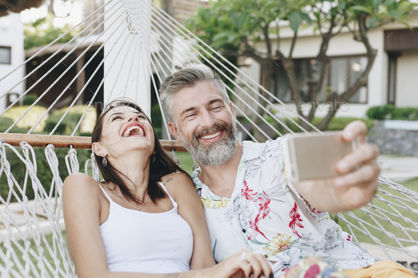 Couple taking a selfie while on vacation - Stock Photo - Images