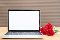 Red rose and laptop mockup on wood_-2 - PhotoDune Item for Sale