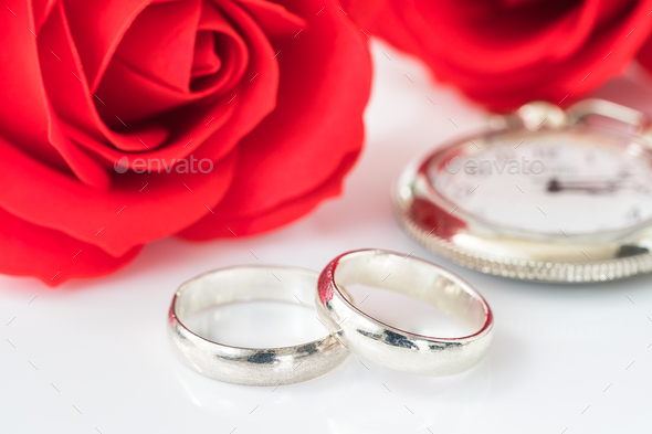 Red rose and wedding ring on white_-3 - Stock Photo - Images