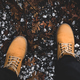 Feet of traveler in yellow boots standing on mountain - PhotoDune Item for Sale
