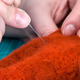 craftsman poking felted cloth with needle close up - PhotoDune Item for Sale