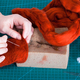 above view of craftsman mixes fibers in felt - PhotoDune Item for Sale