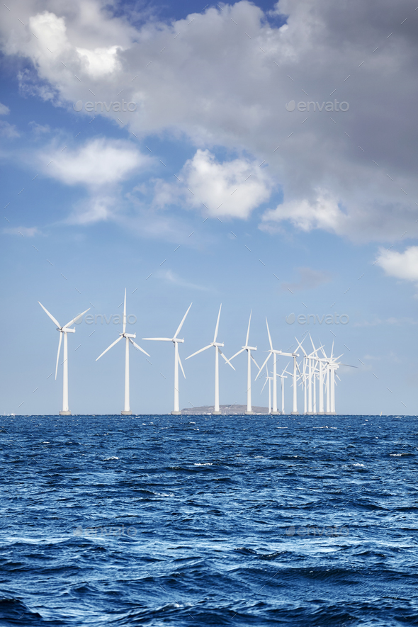Offshore windmill farm on a sunny day - Stock Photo - Images
