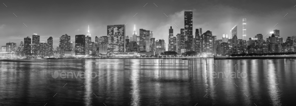 Black and white New York City panorama at night. - Stock Photo - Images