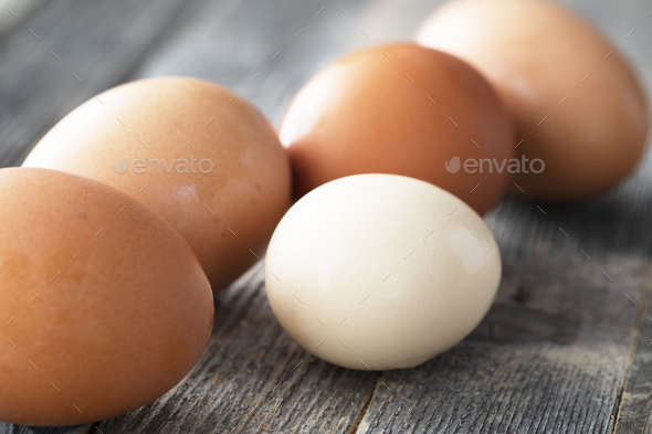 Small and Large Eggs - Stock Photo - Images