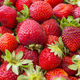 Background of beautiful and juicy strawberries with green leaves - PhotoDune Item for Sale