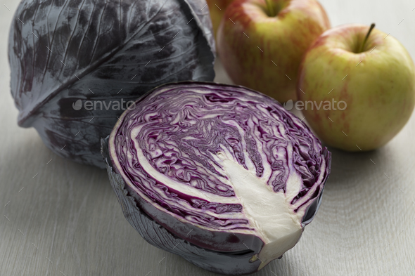 Fresh whole and half raw red cabbage - Stock Photo - Images