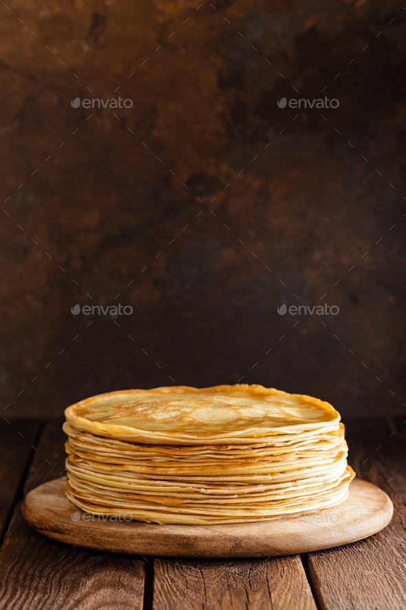 Homemade thin crepes with honey, pancakes on wooden rustic background - Stock Photo - Images