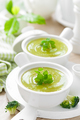 Broccoli soup in bowls on wooden kitchen table closeup. Healthy vegetarian dish. Diet food - PhotoDune Item for Sale