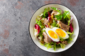 Diet food tuna salad with boiled egg, canned fish, onion and green lettuce top view - PhotoDune Item for Sale