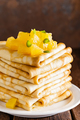 Homemade thin crepes with oranje jam, stack of pancakes on wooden rustic background - PhotoDune Item for Sale