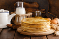 Homemade thin crepes with honey, pancakes on wooden rustic background - PhotoDune Item for Sale