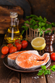 Cooking two fresh raw salmon fish steaks on wooden rustic table closeup - PhotoDune Item for Sale