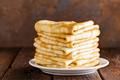 Homemade thin crepes stack, wrapped pancakes on wooden rustic table - PhotoDune Item for Sale