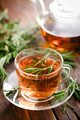 Rosemary tea in glass tea cup on rustic wooden table closeup. Herbal vitamin tea. - PhotoDune Item for Sale