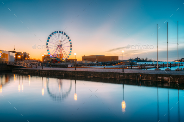 Helsinki, Finland. View Of Embankment With Ferris Wheel In Sunri - Stock Photo - Images