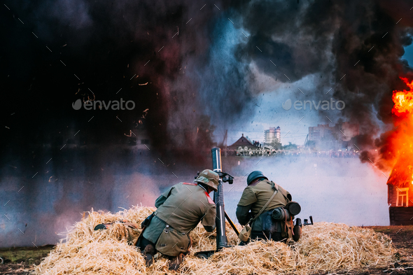 Re-enactors Dressed As World War II German Soldiers Fired From A - Stock Photo - Images